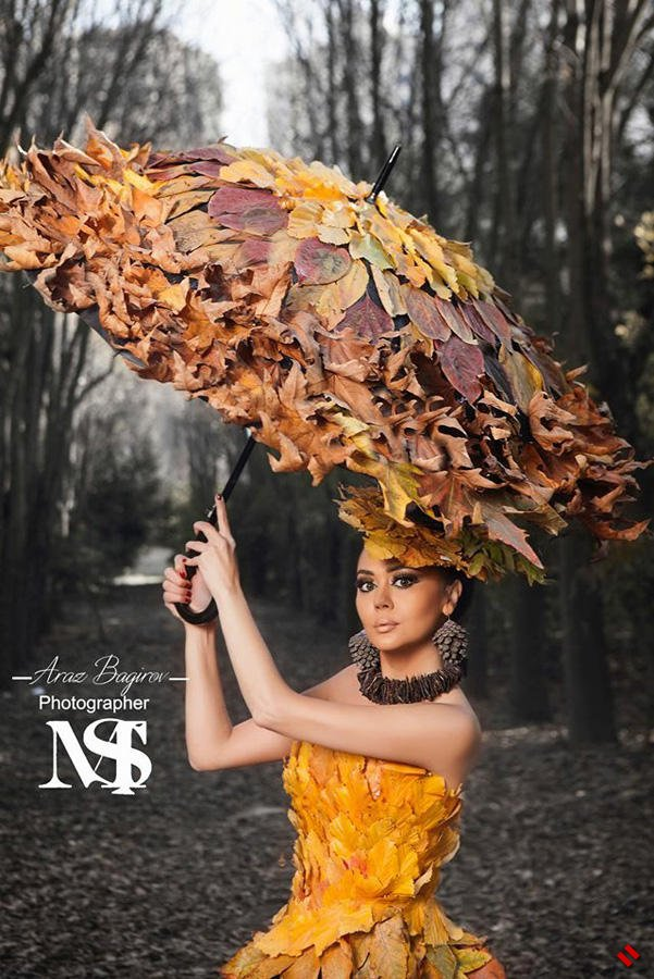 Оксана Расулова в платье из осенней листвы